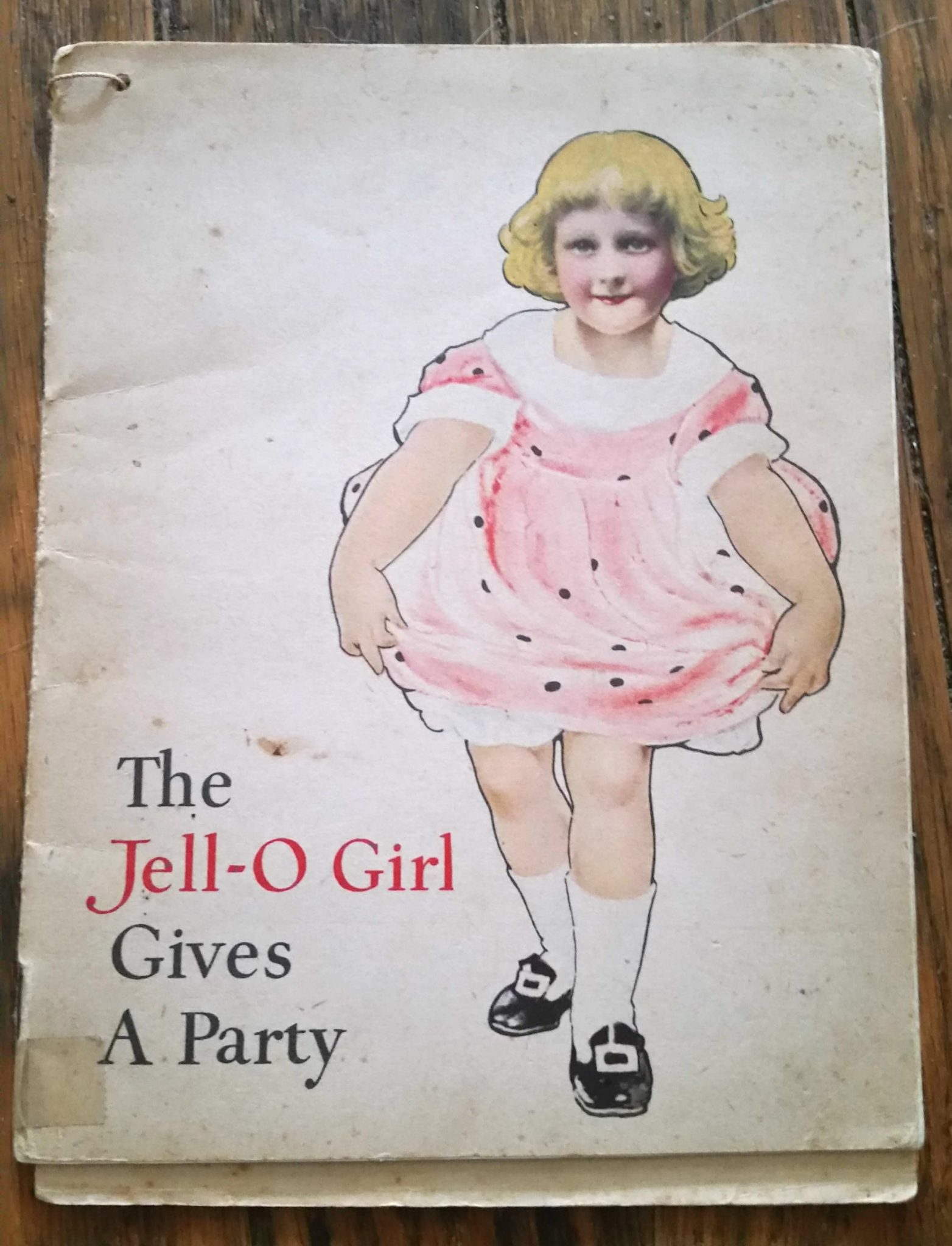 Front cover illustration of a vintage jello cookbook